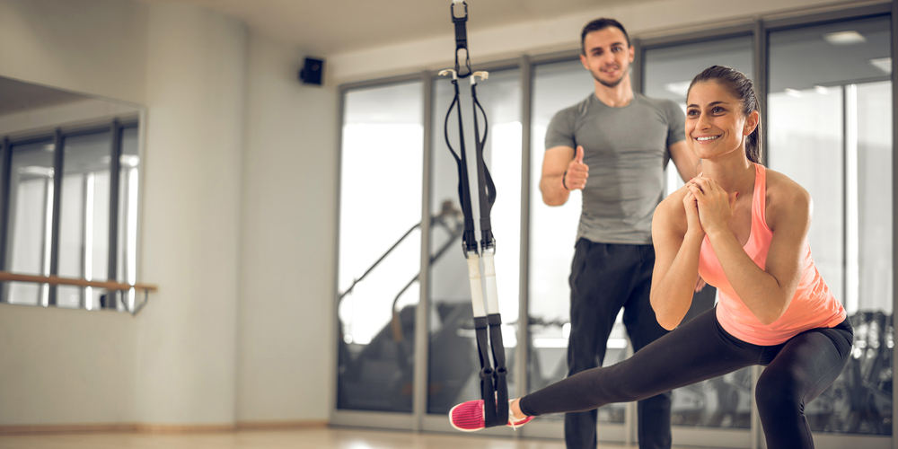 Man and woman in gym working out