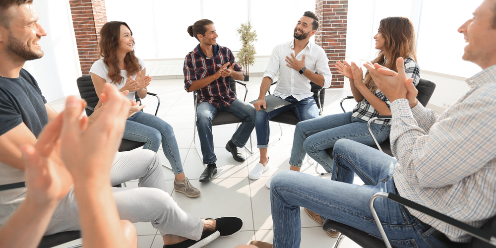 People sitting down in a circle