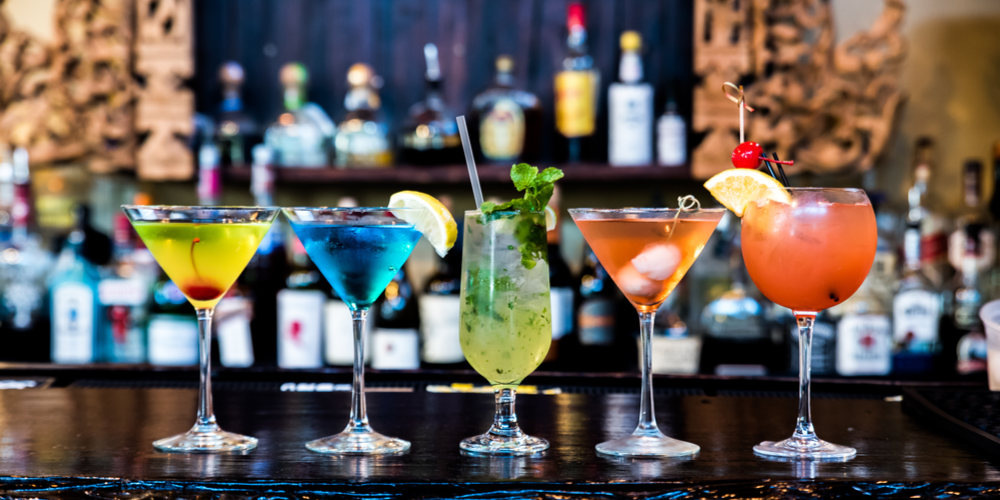 Colorful martinis on top of bar