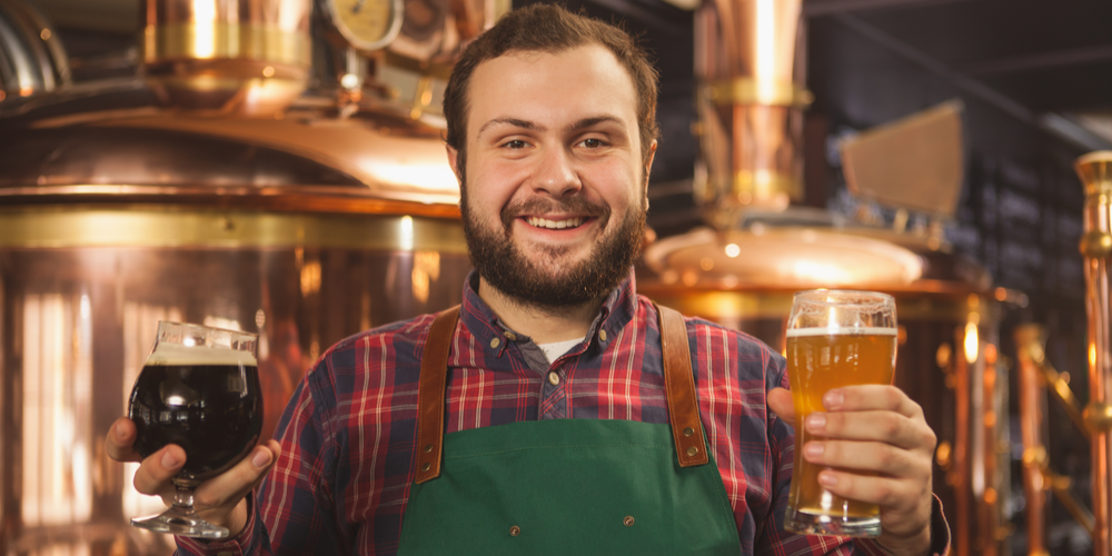 Man holding a glass of beer